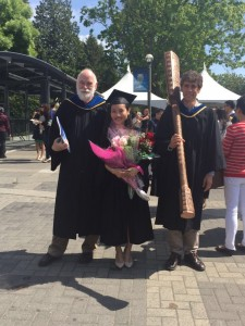 Ms. Ning Ding, 2015 Governor General's Silver Medal in Arts winner (centre), with Prof. Hugh Neary (left), VSE Associate Director and BA (Econ) Program Coordinator, and (right) Prof. Thomas Lemieux, VSE Director.  Dr. Lemieux holds the UBC Ceremonial Mace.